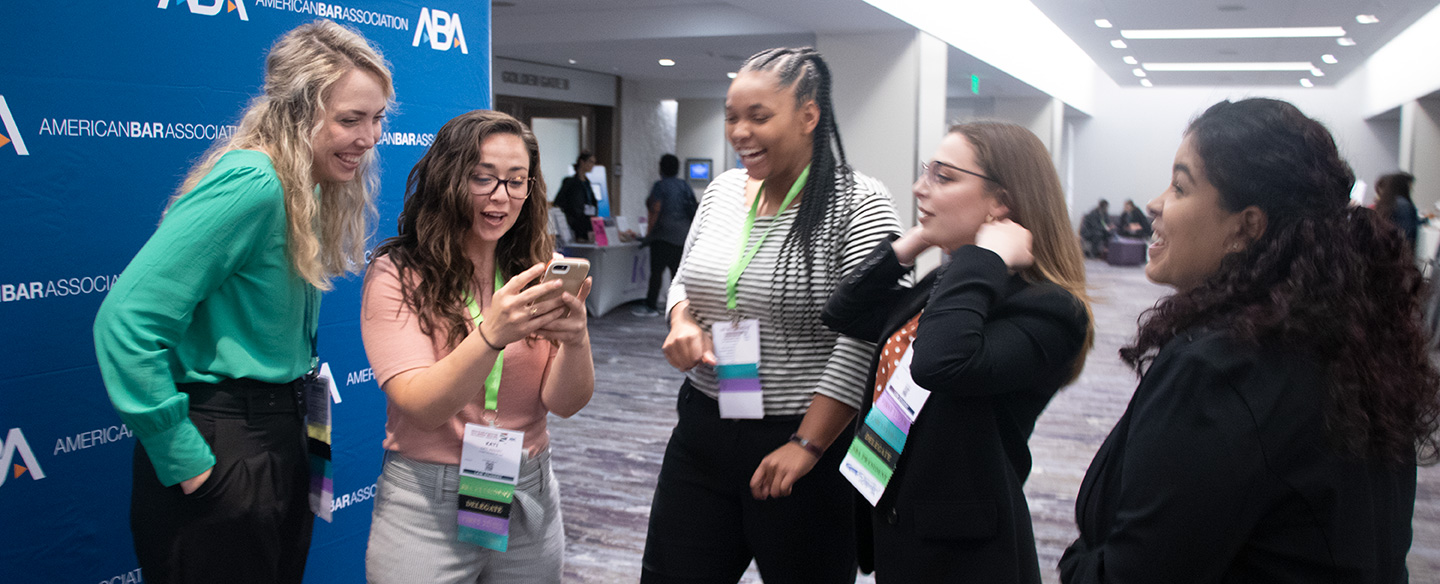 Law students shaking hands at ABA Annual Meeting
