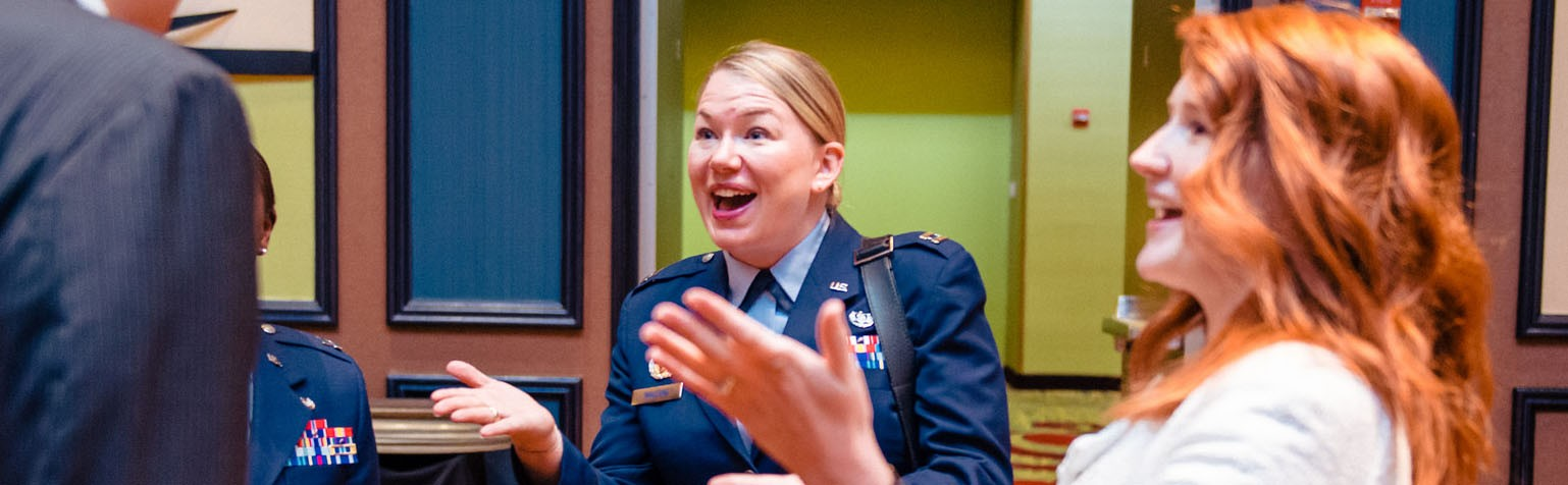Woman in uniform talking to law students.