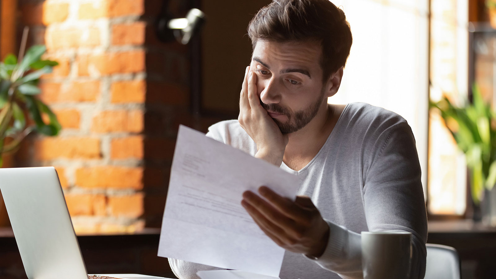 Man worrying over Character and Fitness Application